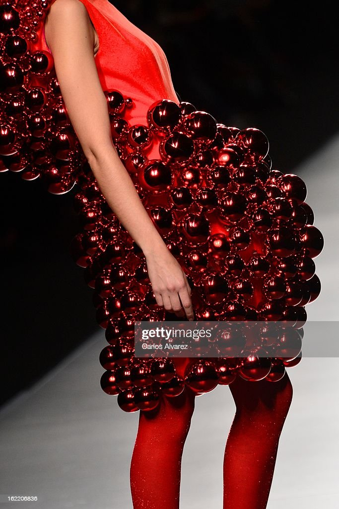 A model showcases designs by Agatha Ruiz de la Prada on the runway at the Agatha Ruiz de la Prada show during Mercedes Benz Fashion Week Madrid Fall/Winter 2013/14 at Ifema on February 20, 2013 in Madrid, Spain.