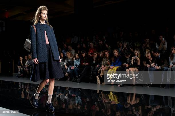 A model showcases designs by Ailanto on the runway at Ailanto show during Mercedes Benz Fashion Week Madrid Fall/Winter 2014 at Ifema on February 15...