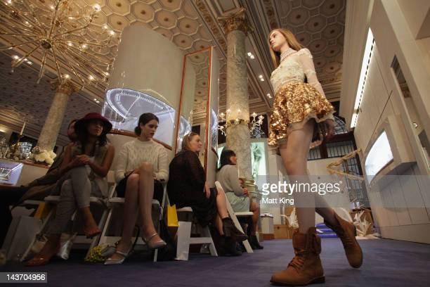 A model showcases designs by AJE on the catwalk on day four of MercedesBenz Fashion Week Australia Spring/Summer 2012/13 at Paspaley Pearls on May 3...
