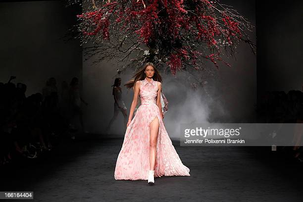 A model showcases designs by Aje on the runway at the Aje show during MercedesBenz Fashion Week Australia Spring/Summer 2013/14 at Carriageworks on...