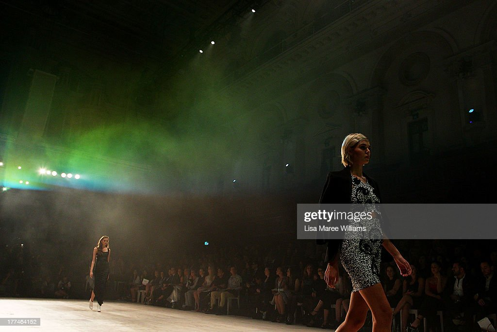 A model showcases designs by Aje on the runway at the InStyle Red Carpet Runway show during Mercedes-Benz Fashion Festival Sydney 2013 at Sydney Town Hall on August 23, 2013 in Sydney, Australia.