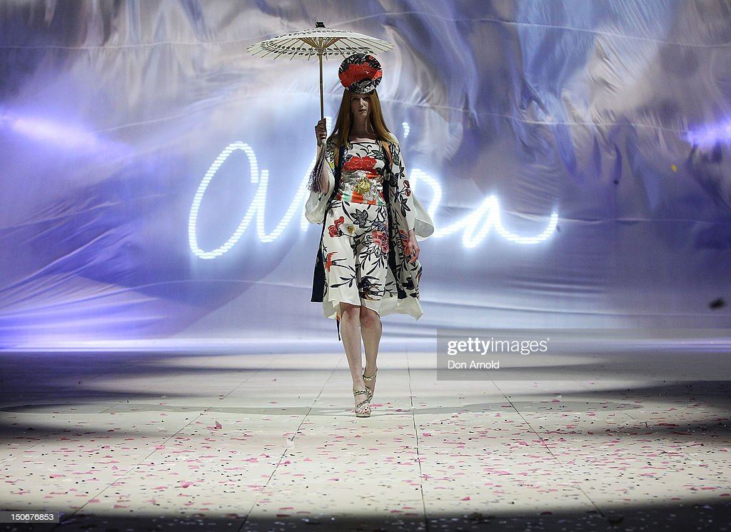A model showcases designs by Akira on the catwalk as part of Mercedes Benz Fashion Festival Sydney 2012 at Sydney Town Hall on August 24 2012 in...