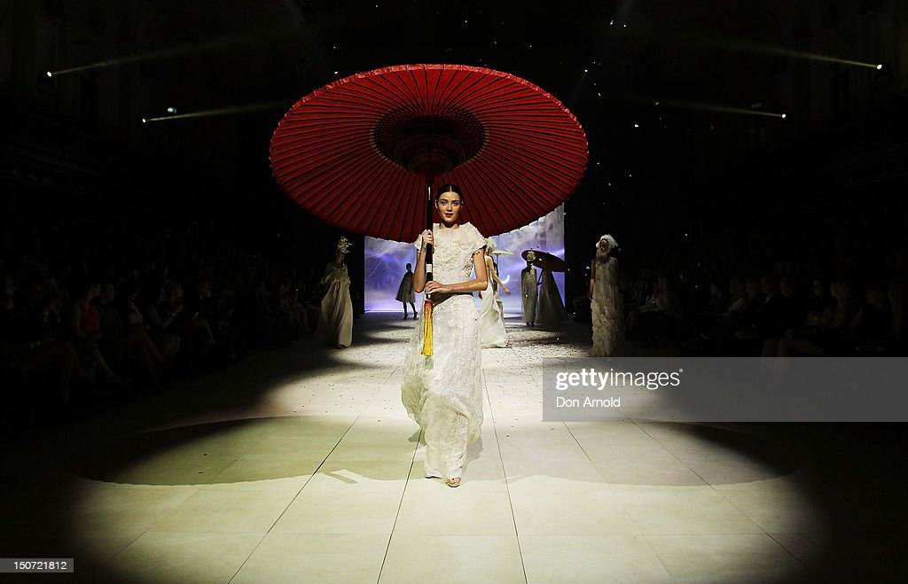 A model showcases designs by Akira on the catwalk as part of Mercedes Benz Fashion Festival Sydney 2012 at Sydney Town Hall on August 25 2012 in...