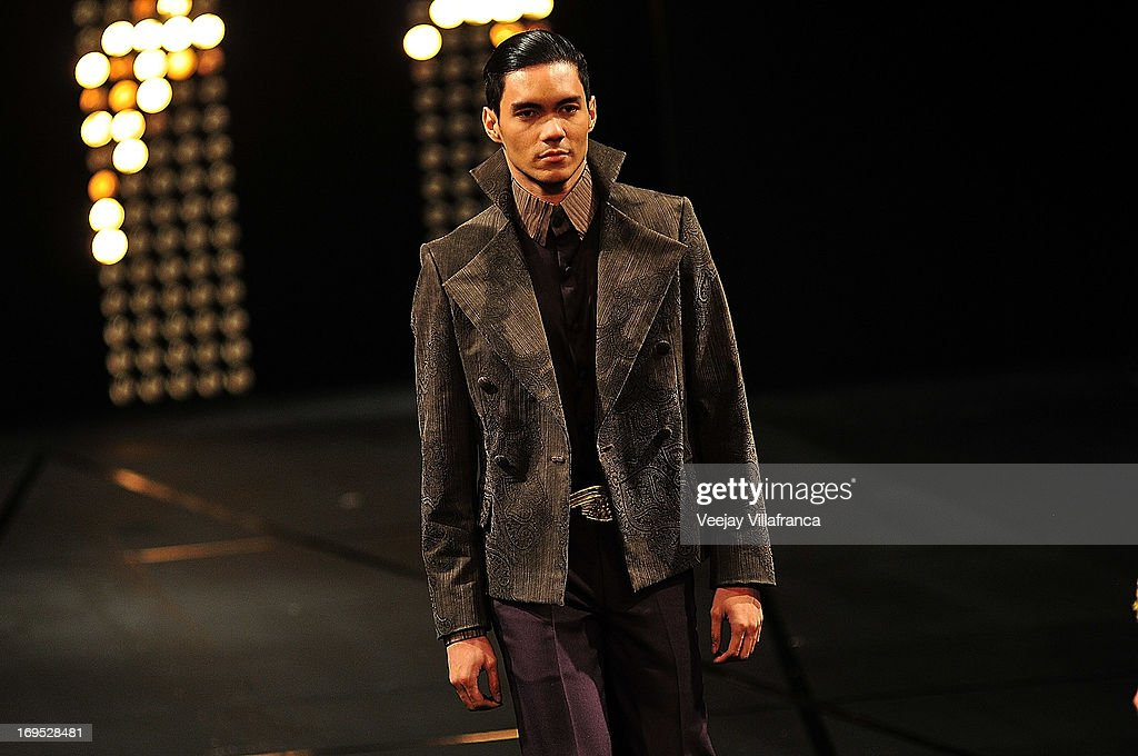 A model showcases designs by Albert Andrada on the runway at the finale show during the last day of the 2013 Philippine Fashion Week Holiday at the SMX convention center in Pasay City on May 26, 2013 in Manila, Philippines.