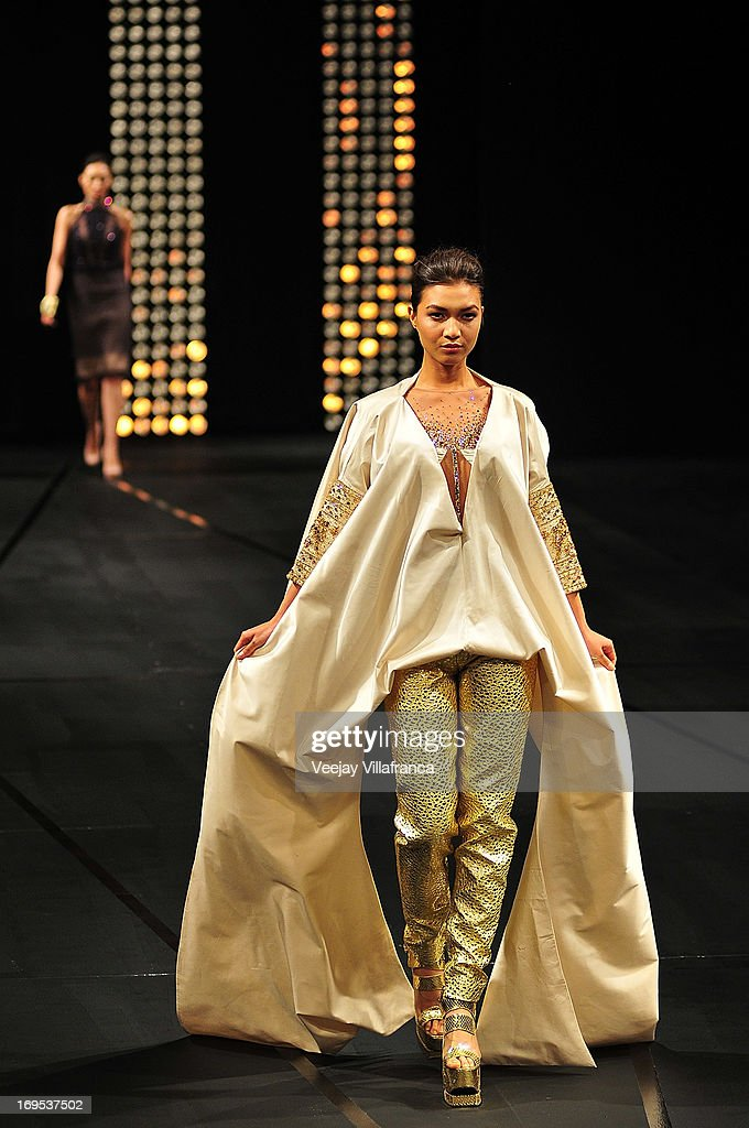 A model showcases designs by Albert Andrada on the runway at the finale show of the 2013 Philippine Fashion Week Holiday at the SMX convention center in Pasay City on May 26, 2013 in Manila, Philippines.