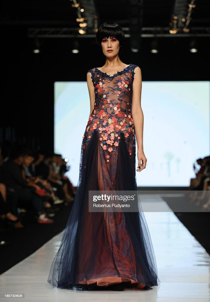 A model showcases designs by Albert Yanuar on the runway at the Enlightenment show during Jakarta Fashion Week 2014 at Senayan City on October 24, 2013 in Jakarta, Indonesia.