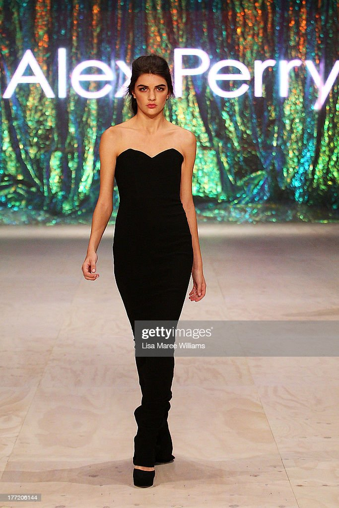 A model showcases designs by Alex Perry on the runway at the InStyle Red Carpet Runway show during Mercedes-Benz Fashion Festival Sydney 2013 at Sydney Town Hall on August 22, 2013 in Sydney, Australia.