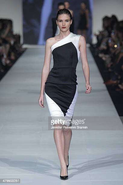 A model showcases designs by Alex Perry on the runway during the Premium Runway 6 Presented by Harper's BAZAAR show at Melbourne Fashion Festival on...