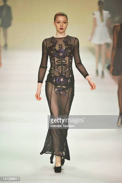 A model showcases designs by Alice McCall during the L'Oreal Paris Runway 6 on day seven of the 2012 L'Oreal Melbourne Fashion Festival on March 14...