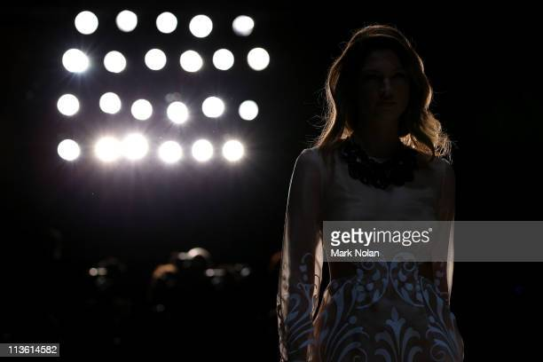 A model showcases designs by Alice McCall on the catwalk during Rosemount Australian Fashion Week Spring/Summer 2011/12 at at Overseas Passenger...