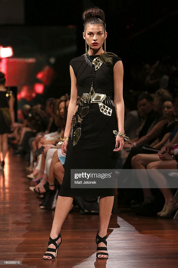 A model showcases designs by Alister Yiap on the runway during Perth Fashion Festival at the Western Australian Museum on September 12, 2013 in Perth, Australia.