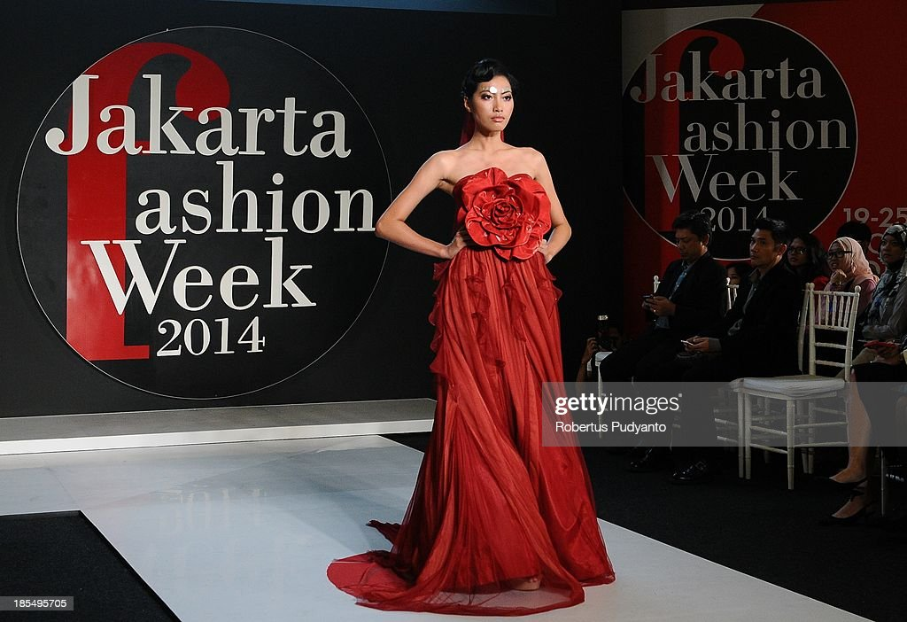 A model showcases designs by Amata of Thailand on the runway during Jakarta Fashion Week 2014 at Senayan City on October 21, 2013 in Jakarta, Indonesia.
