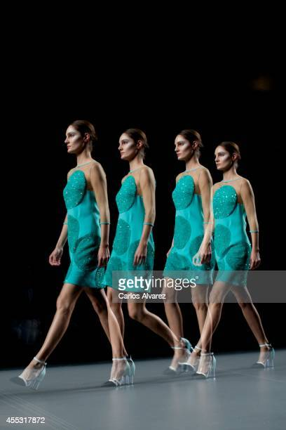 A model showcases designs by Ana Loking on the runway at Ana Loking show during Mercedes Benz Fashion Week Madrid Spring/Summer 2015 at Ifema on...