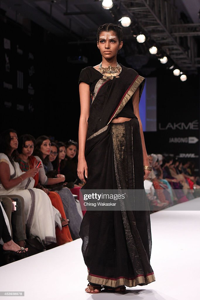 A model showcases designs by Anavila during day 2 of Lakme Fashion Week Winter/Festive 2014 at The Palladium Hotel on August 21, 2014 in Mumbai, India.