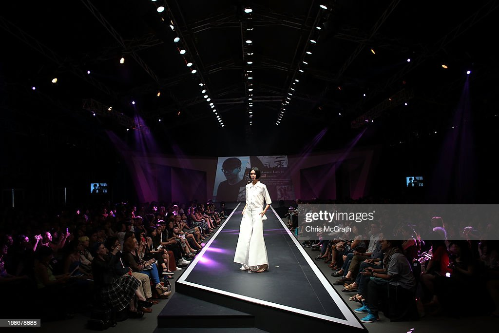 A model showcases designs by Andrew Low of Malaysia during the Audi Star Creation Runway Showdown event at Tent@Marina Promenade on May 13, 2013 in Singapore.