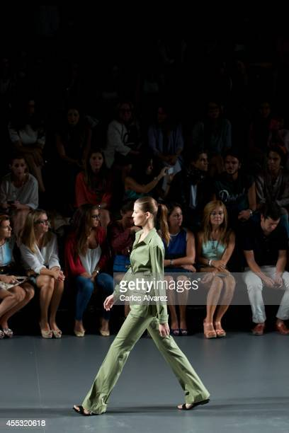 A model showcases designs by Angel Schlesser on the runway at Angel Schlesser show during Mercedes Benz Fashion Week Madrid Spring/Summer 2015 at...