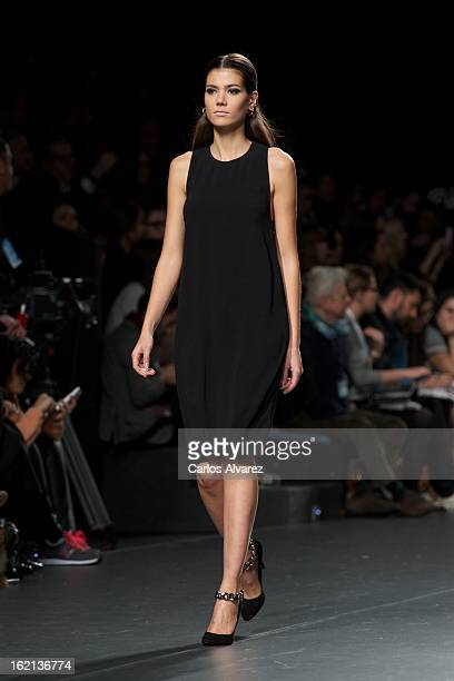 A model showcases designs by Angel Schlesser on the runway at the Angel Schlesser show during Mercedes Benz Fashion Week Madrid Fall/Winter 2013/14...