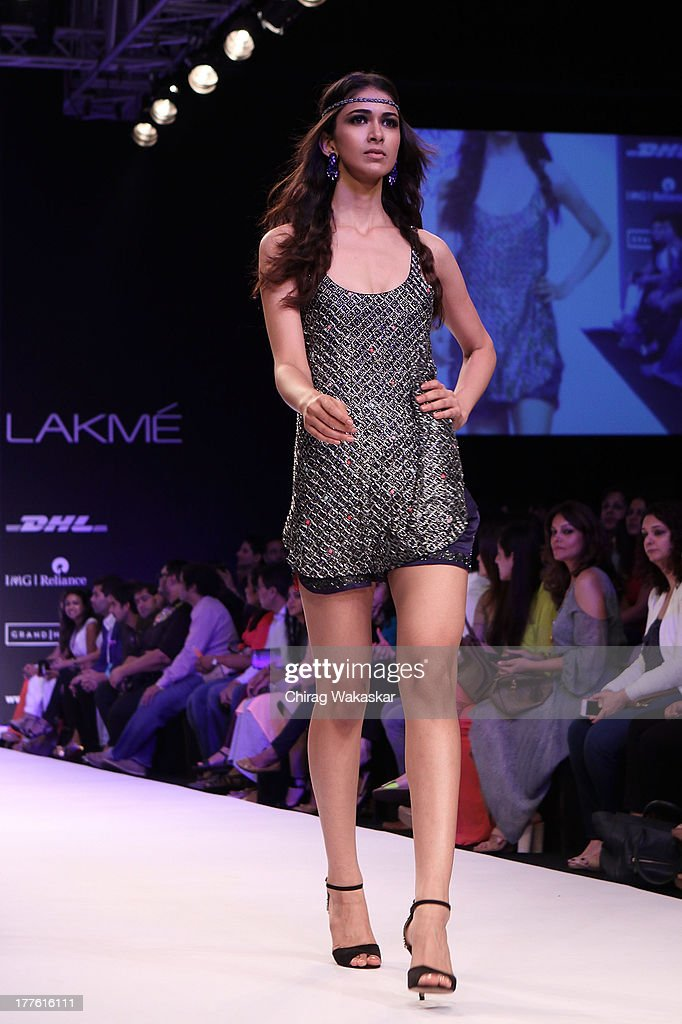 A model showcases designs by Anushka Khanna on the runway during day 2 of Lakme Fashion Week Winter/Festive 2013 at the Hotel Grand Hyatt on August 24, 2013 in Mumbai, India.