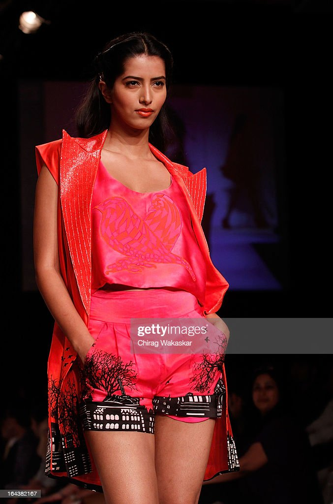 A model showcases designs by Anushka Khanna on the runway during day two of the Lakme Fashion Week Summer/Resort 2013 on March 23, 2013 at Grand Hyatt in Mumbai, India.