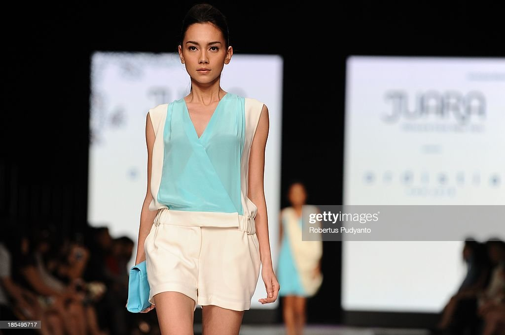 A model showcases designs by Ardistia New York at the Juara show on the runway during Jakarta Fashion Week 2014 at Senayan City on October 21, 2013 in Jakarta, Indonesia.