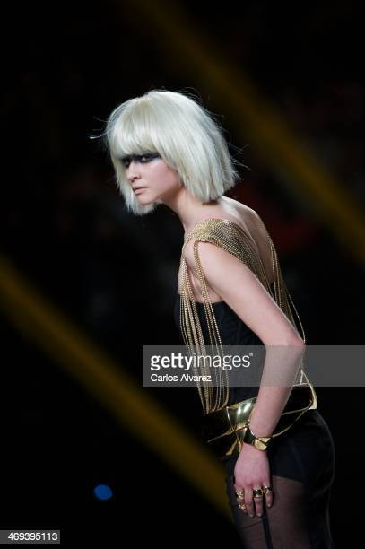 A model showcases designs by Aristocrazy on the runway at Aristocrazy show during Mercedes Benz Fashion Week Madrid Fall/Winter 2014 at Ifema on...