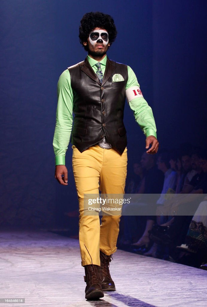 A model showcases designs by Arjun Khanna on the runway during day three of Lakme Fashion Week Summer/Resort 2013 on March 24, 2013 at Grand Hyatt in Mumbai, India.