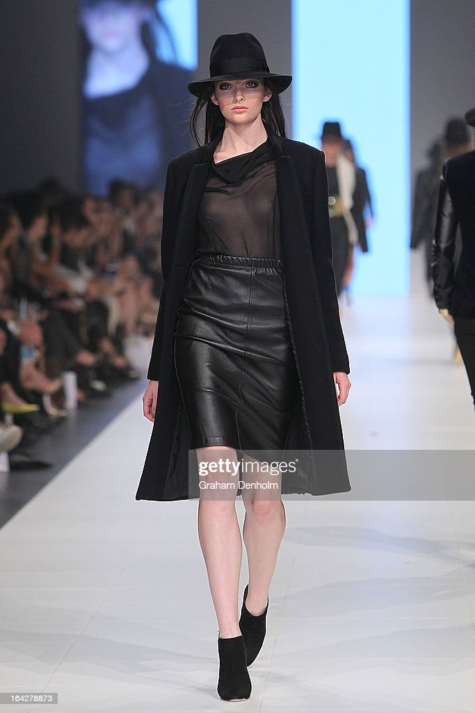 A model showcases designs by Arthur Galan on the runway at the L'Oreal Paris Runway 5 show during day five of L'Oreal Melbourne Fashion Festival on...