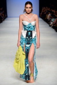 A model showcases designs by Ash to Gold on the catwalk during the New Generation 2 group show on day five of Mercedes Benz Fashion Week Australia...