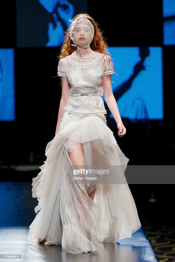 A model showcases designs by Aurelio Costarella on the catwalk during StyleAID 2013 at Crown Perth on August 9, 2013 in Perth, Australia.