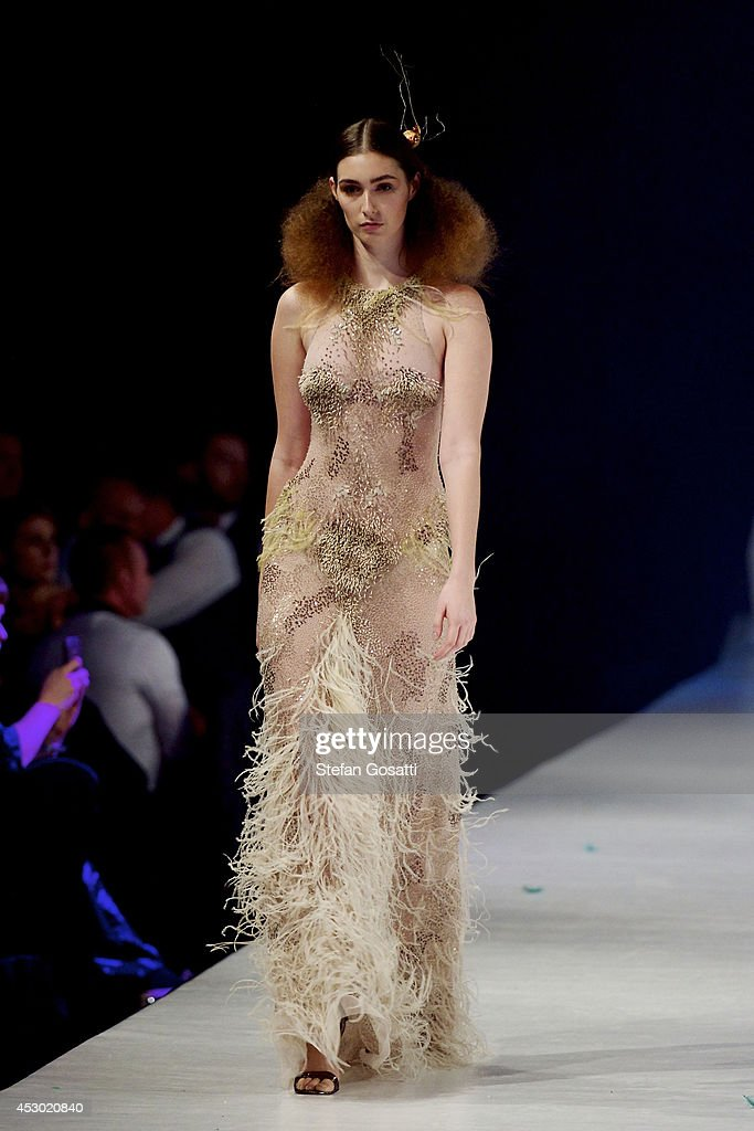 A model showcases designs by Aurelio Costarella on the catwalk during Styleaid Mythic at Crown on August 1, 2014 in Perth, Australia.