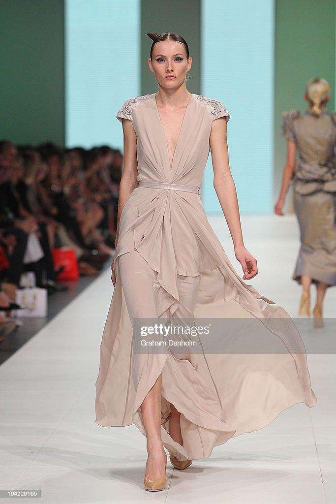 A model showcases designs by Aurelio Costarella on the runway at the L'Oreal Paris Runway 4 show during day four of L'Oreal Melbourne Fashion Festival on March 21, 2013 in Melbourne, Australia.