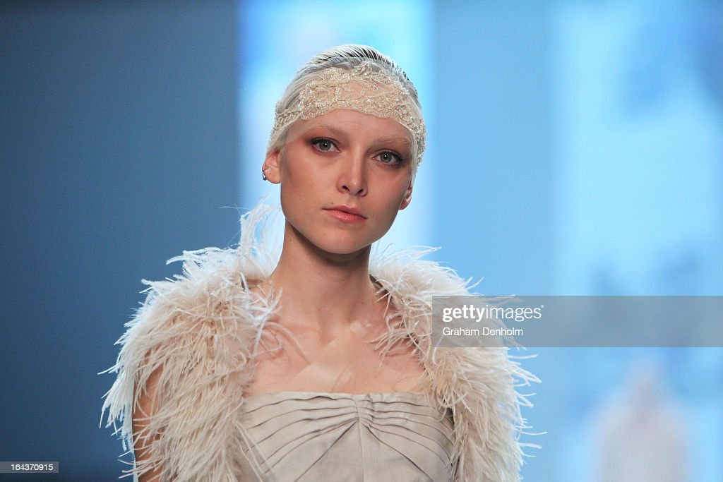 A model showcases designs by Aurelio Costarella on the runway at the Red Carpet Runway show during day six of L'Oreal Melbourne Fashion Festival on March 23, 2013 in Melbourne, Australia.