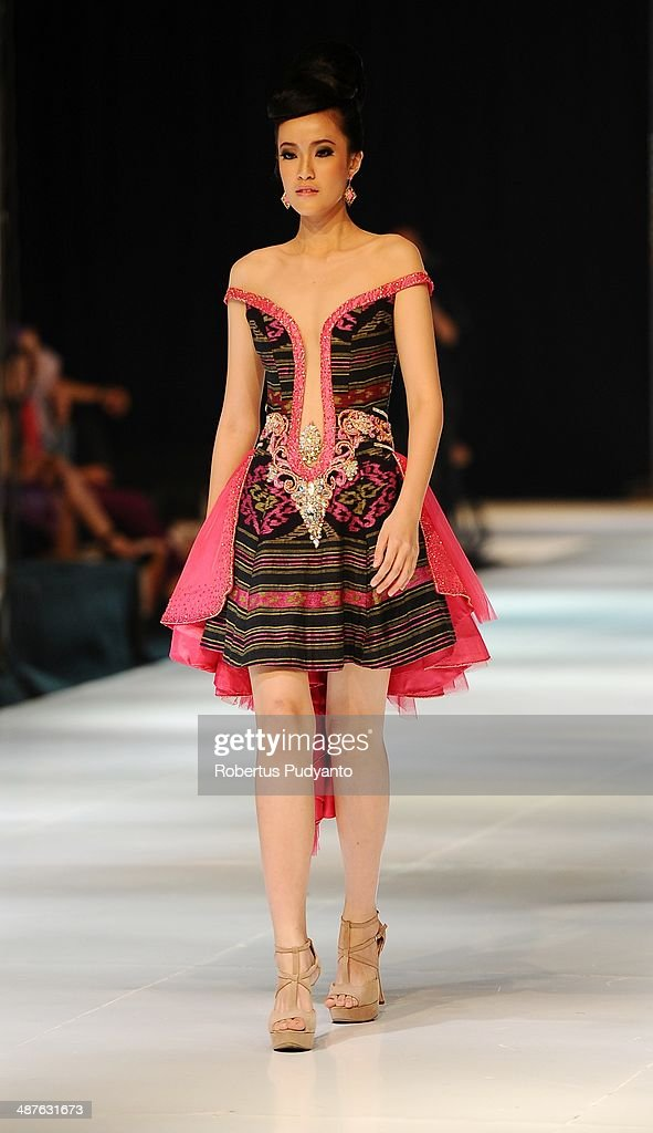 A model showcases designs by Ayok Dwipancara on the runway at Pelangi Khatulistiwa show during The 7th Surabaya Fashion Parade 'NIWASANA NUSANTARA 2014' at Tunjungan Plaza on on May 1, 2014 in Surabaya, Indonesia.