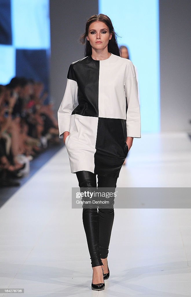 A model showcases designs by Bassike on the runway at the L'Oreal Paris Runway 5 show during day five of L'Oreal Melbourne Fashion Festival on March...