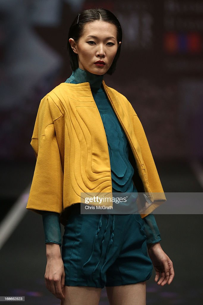A model showcases designs by Batmunkh Uugantuya of Mongolia during the Audi Star Creation Runway Showdown event at Tent@Marina Promenade on May 13, 2013 in Singapore.