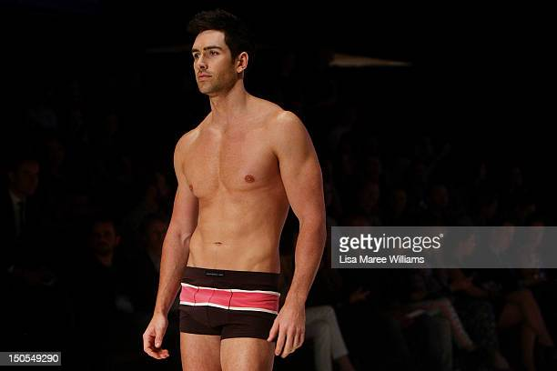 A model showcases designs by Bendon presents Macpherson Men on the catwalk as part of the Mercedes Benz Fashion Festival Sydney 2012 at Sydney Town...