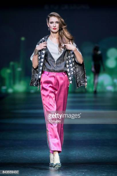 A model showcases designs by byu Designs on the runway during the Designers' Collection Show 1 on Day 2 of the CentreStage Hong Kong 2017 at Hong...