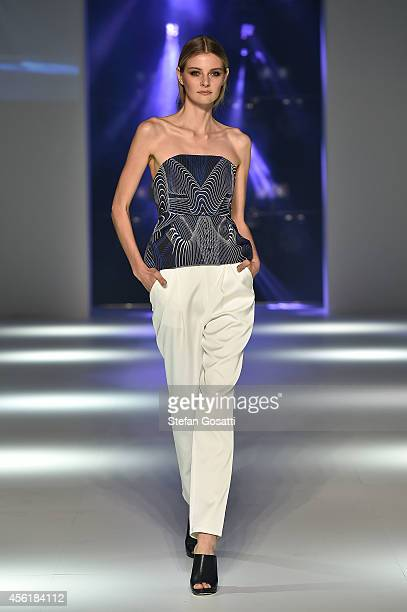 A model showcases designs by Cameo the Label during the Australian Fashion Labels show at MercedesBenz Fashion Festival Sydney at Sydney Town Hall on...