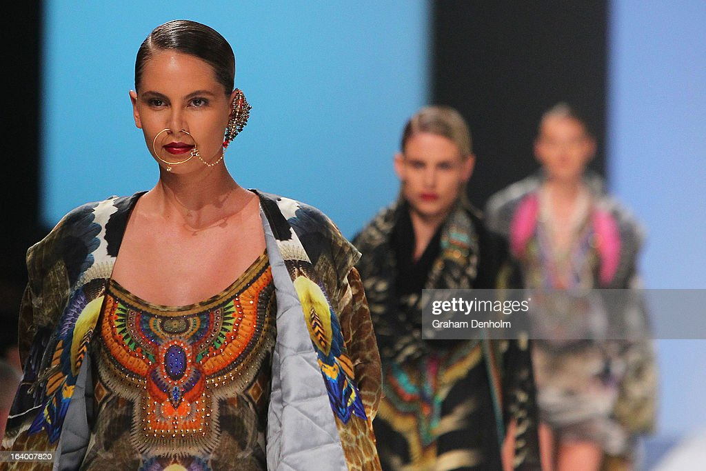 A model showcases designs by Camilla during the L'Oreal Melbourne Fashion Festival Opening Event presented by David Jones at Docklands on March 19, 2013 in Melbourne, Australia.