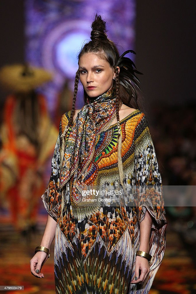 A model showcases designs by Camilla on the runway during the Camilla show as part of 2014 Virgin Australia Melbourne Fashion Festival at Docklands on March 19, 2014 in Melbourne, Australia.