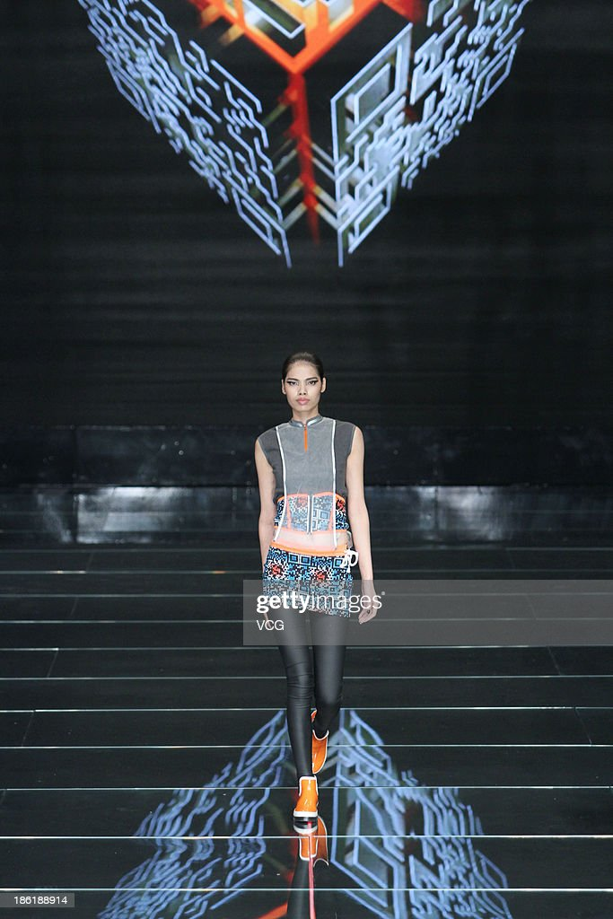 A model showcases designs by Chen Jianping on the runway at the QIAODAN Chen Jianping Sports Wear Collection show during Mercedes-Benz China Fashion Week Spring/Summer 2014 at 751 D.PARK Workshop on October 28, 2013 in Beijing, China.