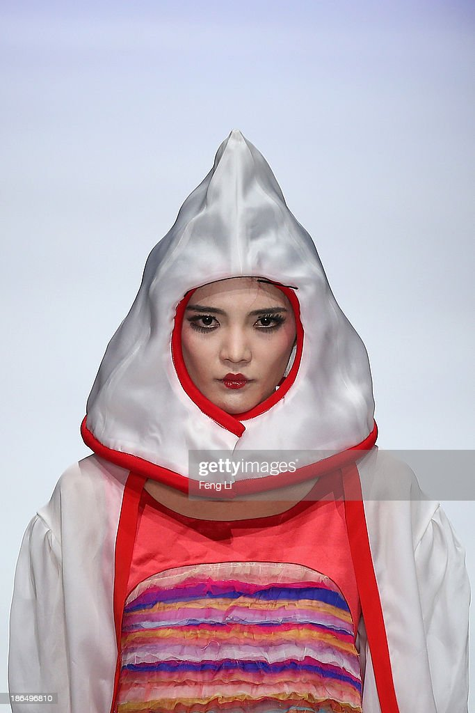 A model showcases designs by Chinese designer Cao Qinghe on the runway at HEMPEL Designer Salon Collection show during Mercedes-Benz China Fashion Week Spring/Summer 2014 at 751 D-PARK Central Hall on October 31, 2013 in Beijing, China.