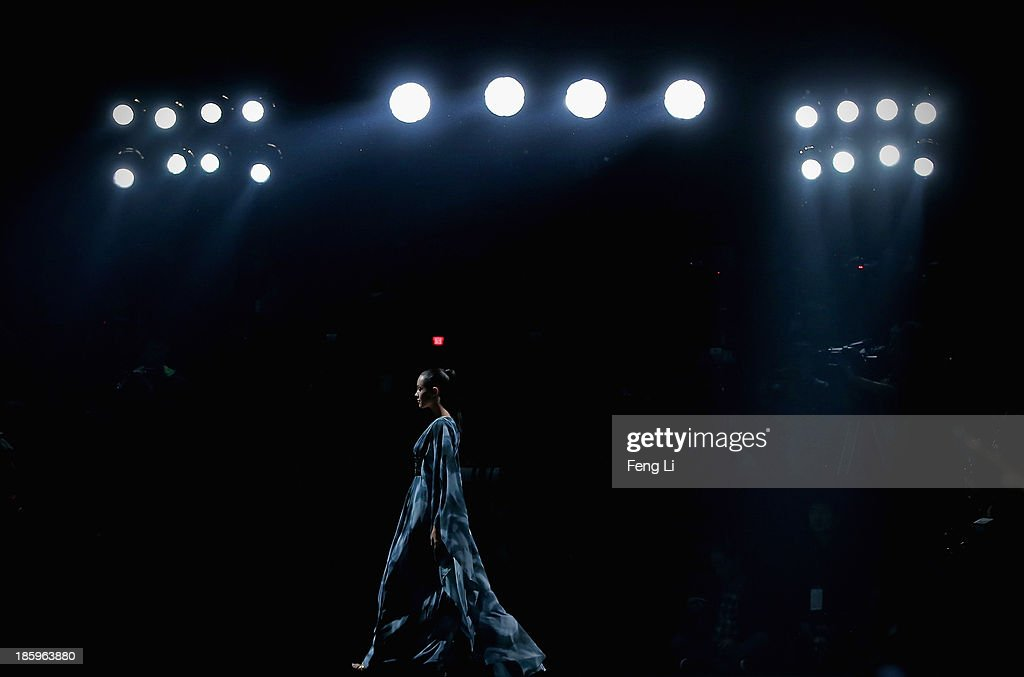 A model showcases designs by Chinese designer Lin Ruoping on the runway at STELLA LAM Lin Ruoping Dress Collection show during Mercedes-Benz China Fashion Week Spring/Summer 2014 at 751 D-PARK Workshop on October 26, 2013 in Beijing, China.