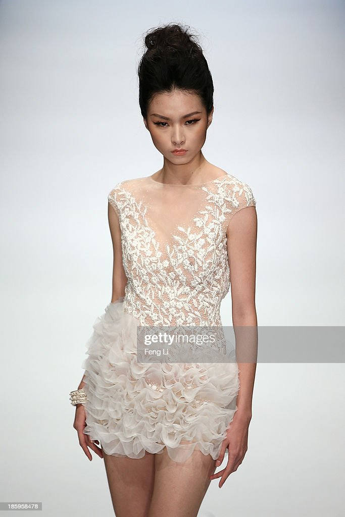 A model showcases designs by Chinese designer Zhang Jingjing on the runway at Zhang Jingjing Haute Couture Collection show during Mercedes-Benz China Fashion Week Spring/Summer 2014 at 751 D-PARK Central Halll on October 26, 2013 in Beijing, China.