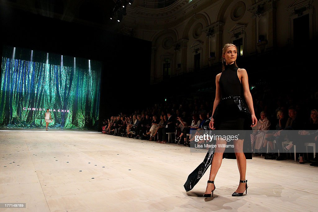 A model showcases designs by Christina Exie on the runway at the MBFWA Trends show during Mercedes-Benz Fashion Festival Sydney 2013 at Sydney Town Hall on August 21, 2013 in Sydney, Australia.
