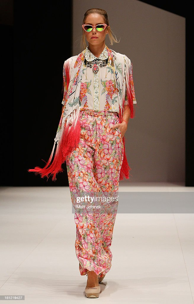A model showcases designs by Christine on the catwalk on day 2 of Melbourne Spring Fashion Week 2012 at Melbourne Town Hall on September 4, 2012 in Melbourne, Australia.
