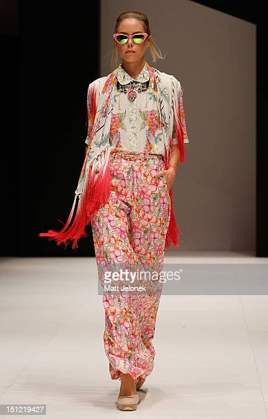 A model showcases designs by Christine on the catwalk on day 2 of Melbourne Spring Fashion Week 2012 at Melbourne Town Hall on September 4 2012 in...