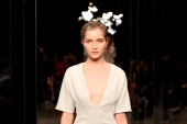 A model showcases designs by Christopher Esber on the catwalk on day four of MercedesBenz Fashion Week Australia Spring/Summer 2012/13 at the...