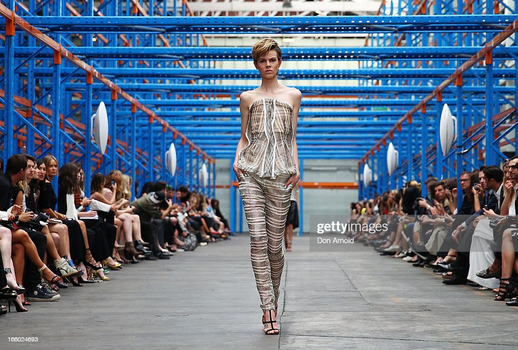 A model showcases designs by Christopher Esber on the runway at the Christopher Esber show during Mercedes-Benz Fashion Week Australia Spring/Summer 2013/14 in Marrickville on April 8, 2013 in Sydney, Australia.