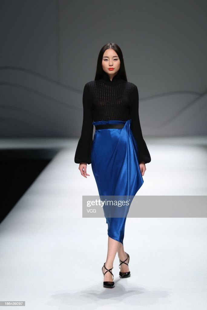A model showcases designs by Chu Yan on the runway at the CHUHETINGXIANG Chu Yan Collection show during Mercedes-Benz China Fashion Week Spring/Summer 2014 at Beijing Hotel on October 31, 2013 in Beijing, China.